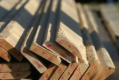 a stack of unfinished lumber